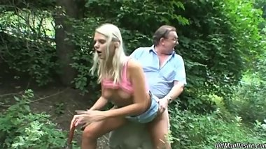Blonde beauty gets doggystyled outdoors by an older dude